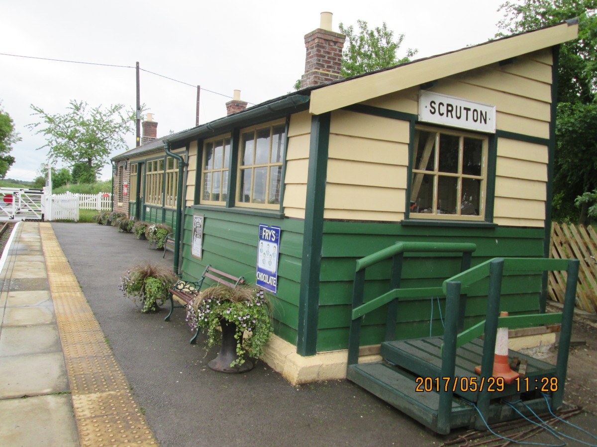 A look along the platform, west-to-east, shows the old platform signal cabin in line with the station building (SM's office, booking office, waiting rooms)