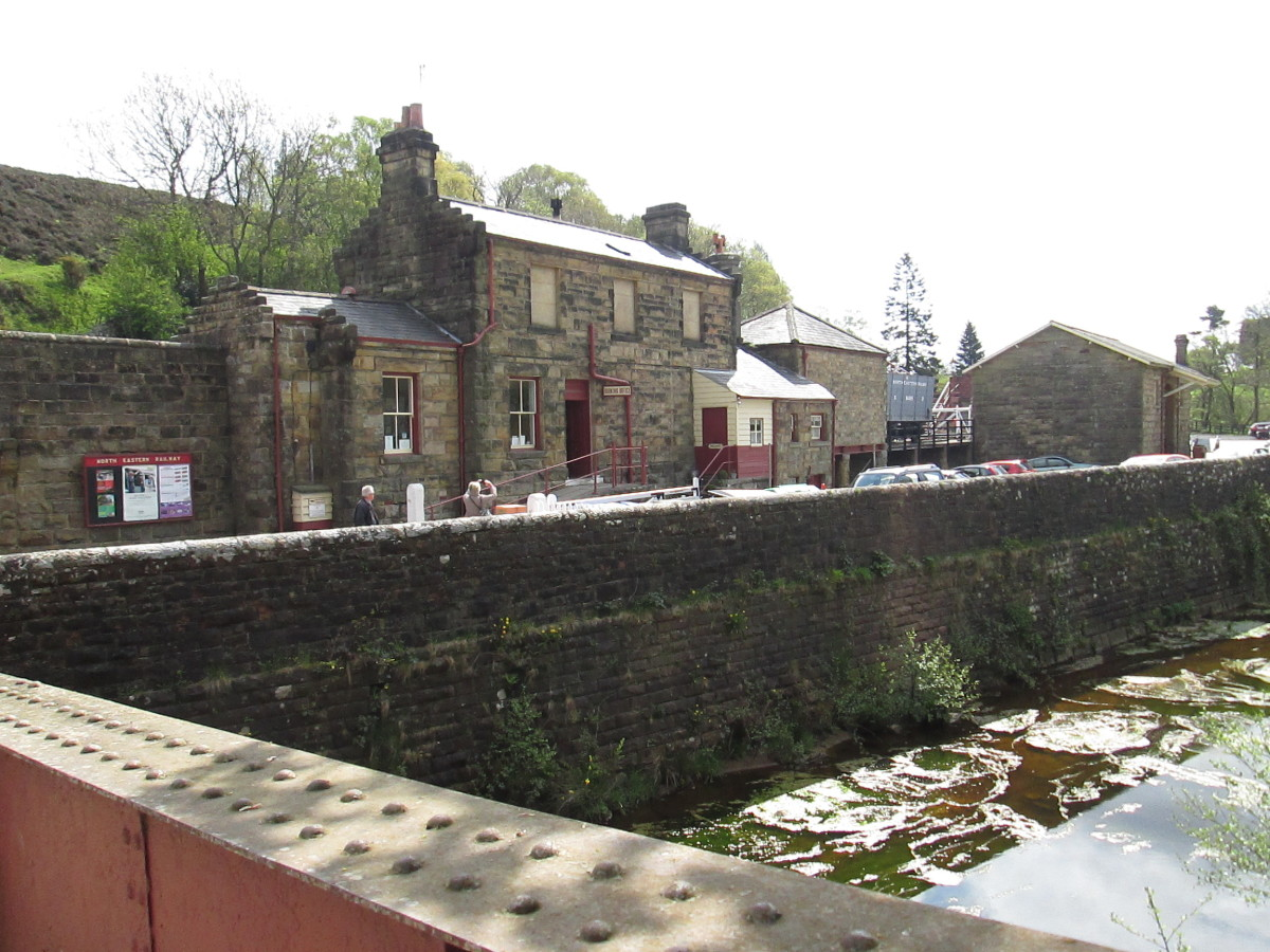 Goathland Station seen from across Goathland Beck - the village is worth a couple of hours' visit, the centre stage of 'Heartbeat' country