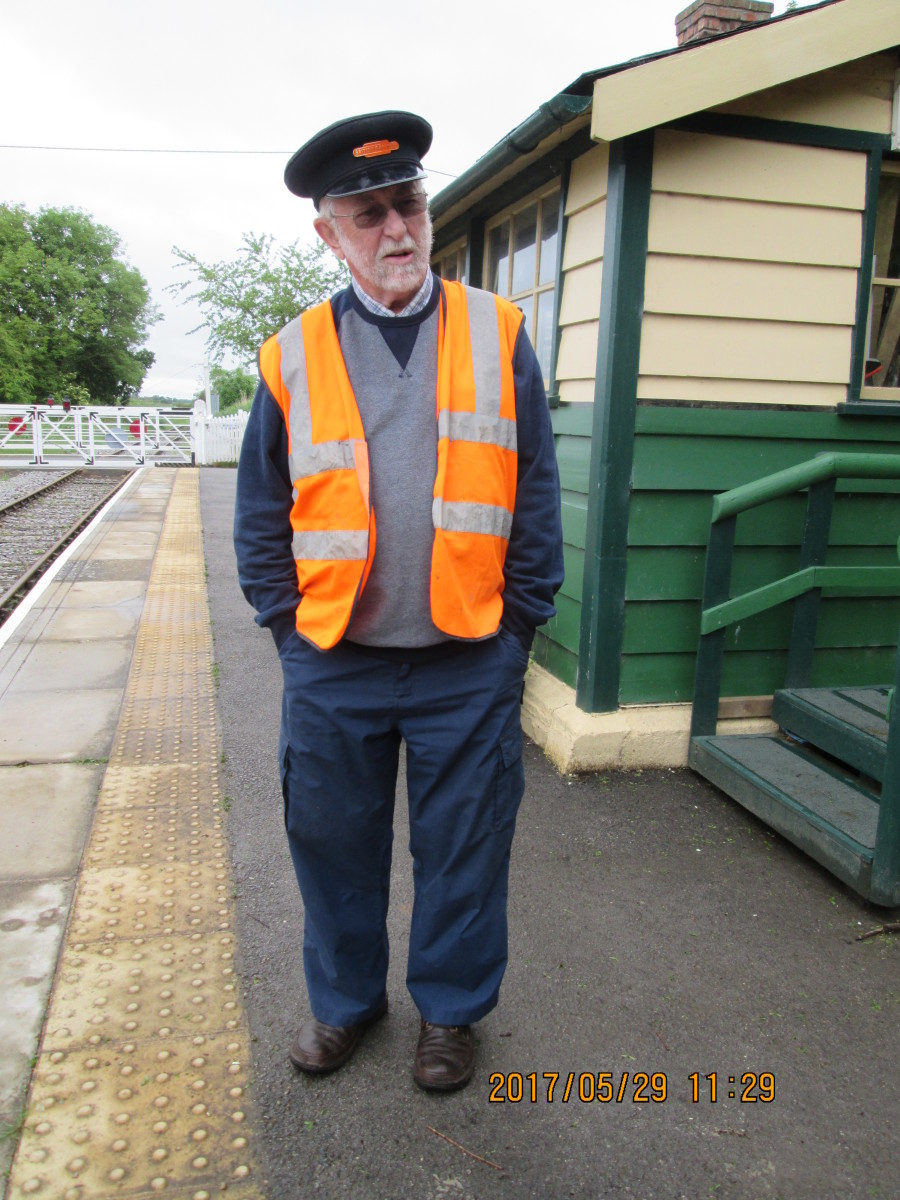 One of the WR volunteers kindly dons a British Railways station staff cap with tangerine 'British Railways' badge over the peak