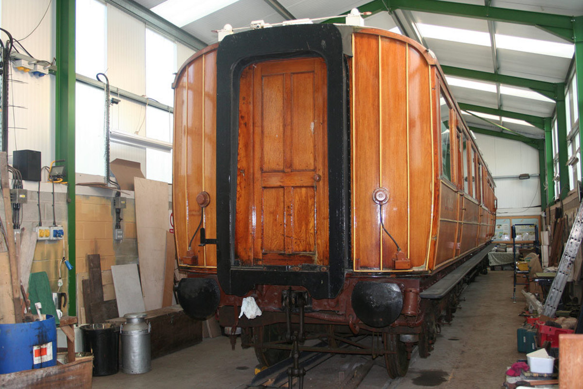 Work complete on a carriage, the corridor connection sets off the panel work and underframe paintwork