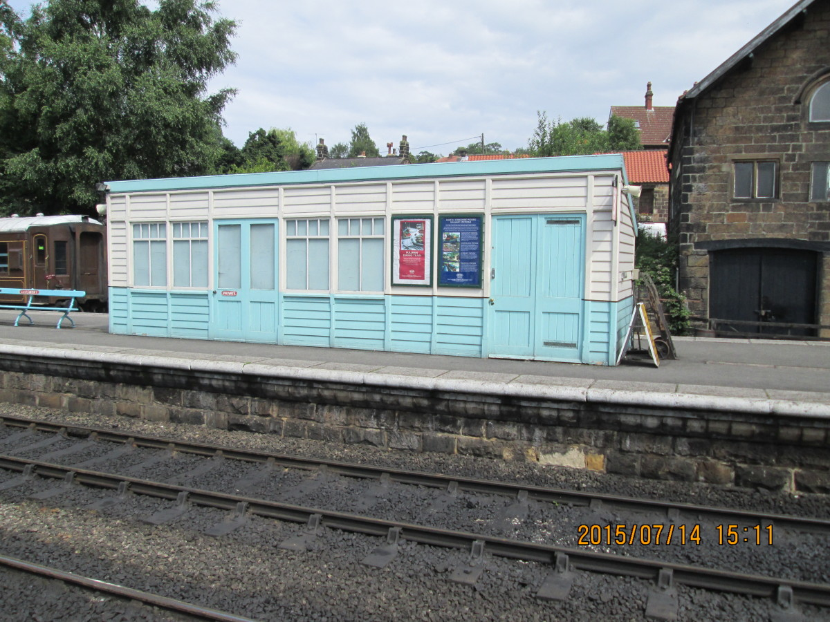 Enclosed platform shelter built in North Eastern Railway style on the former 'Up' platform, painted in British Railways' North Eastern Region blue and white as are the stairs on the signal cabin.