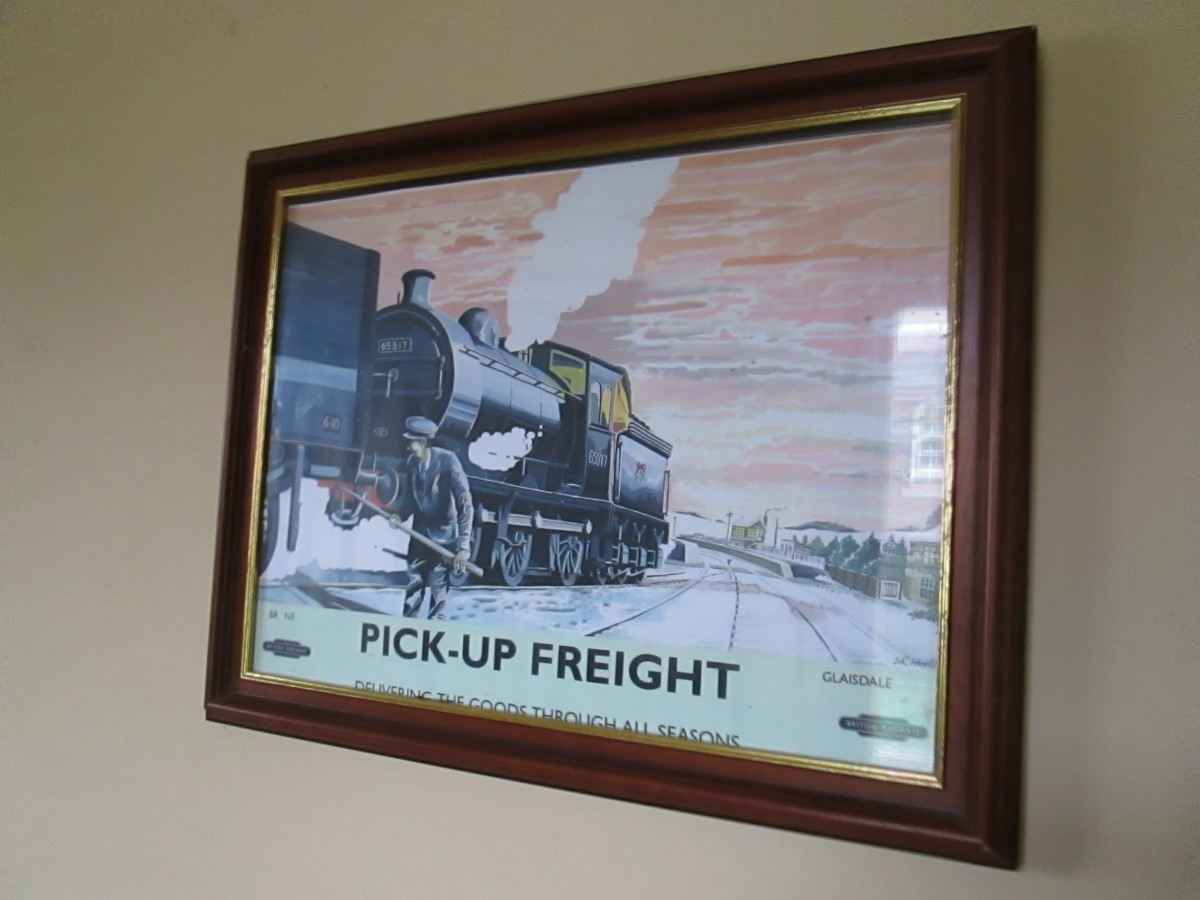 Framed and glazed public information poster shows daily pick-up goods service provided by the railway company (the caption just tells you the scene is Glaisdale on the Whitby-Middlesbrough route)