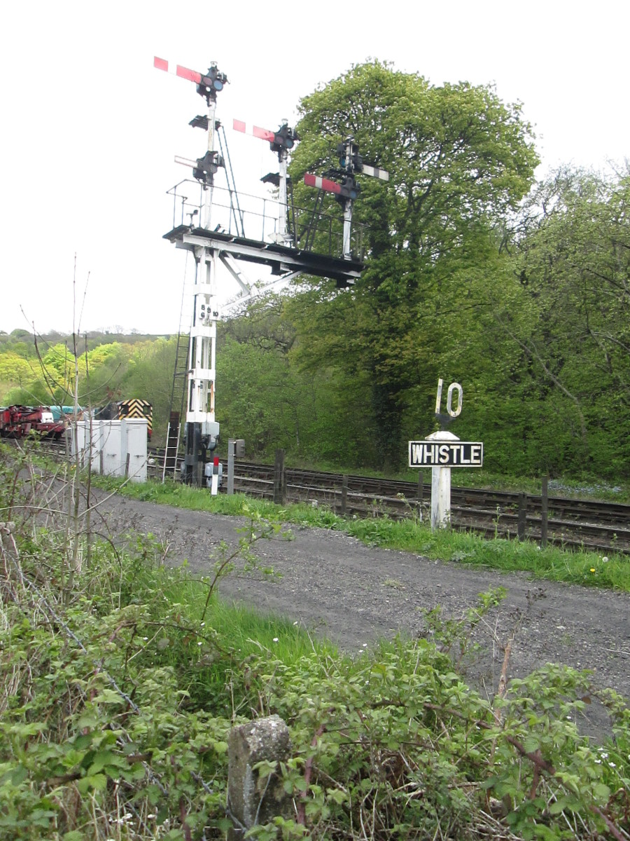 Late LNER Bracket Post with signal arms to warn of shed movements and possible obstructions through the tunnel - 10 mph speed restriction and 'Whistle' board positioned ahead of triple doll post.