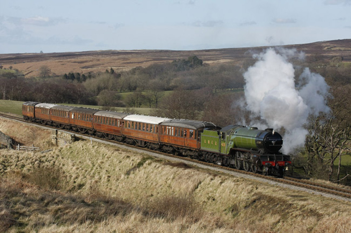 Preserved Class V2 4771 'Green Arrow' takes a rake of restored LNERCA Gresley stock for a spin near the highest point of the NYMR line into Newtondale past Fylingdale's early warning station