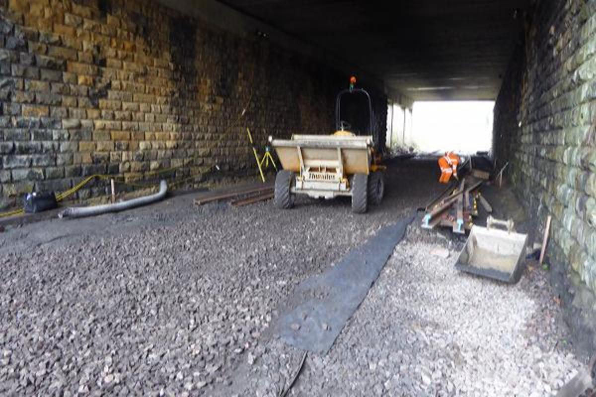Under the bridge, the trackbed has been prepared to lay the pointwork