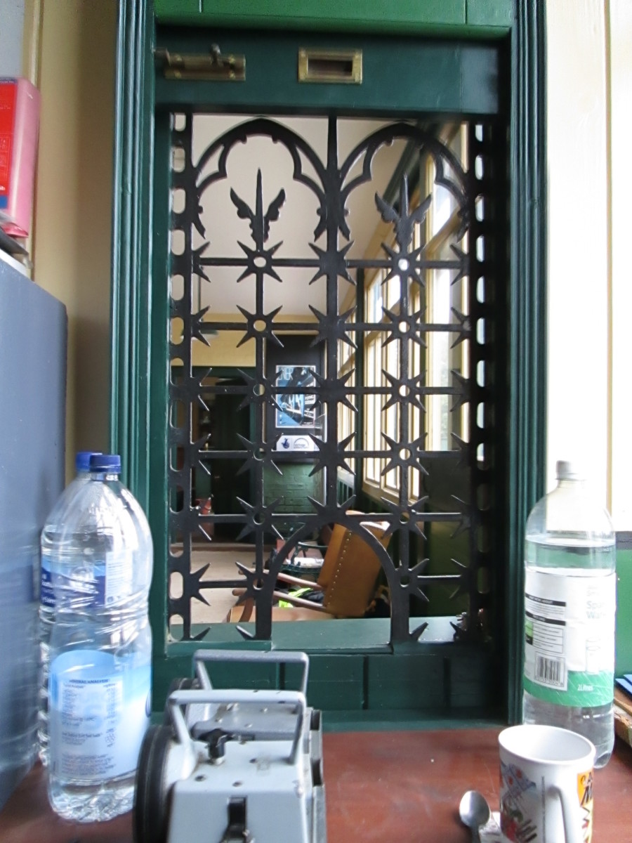 A view through the ornate booking office window into the general waiting room