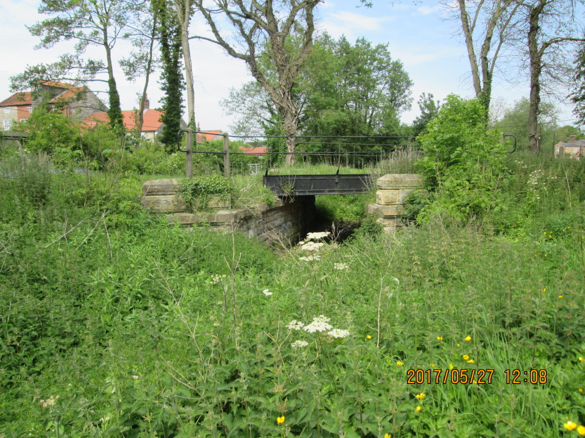Another of the three cast-iron bridges, both now being on privately owned land. This one crosses a stone-built storm drain to a public footpath