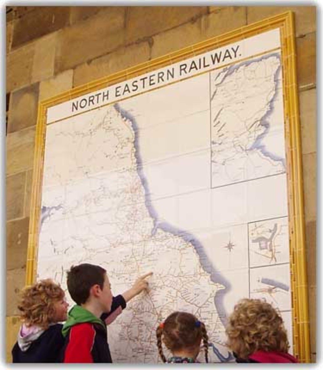 North Eastern Tile network wall map installed at Pickering 2009 is investigated by a group of children. A girl points to her own local station on the western edge of the North Yorkshire Moors (one of many closed in the 1950s and 1960s)