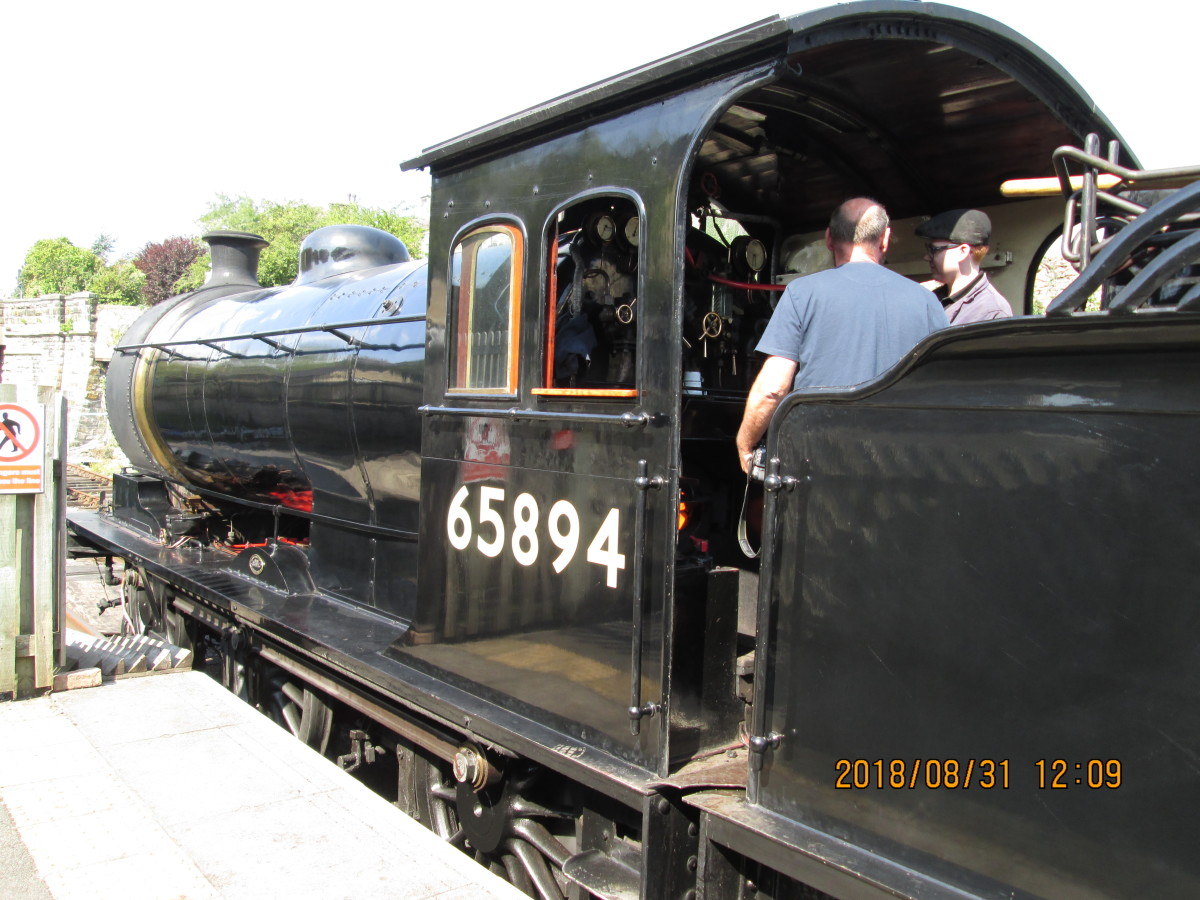 A footplate visitor is shown around - there's a lot to take in, with levers, dials and brakes (both on the locomotive and tender)
