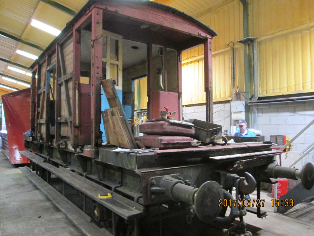 In the permanent way workshop beside the NYMR line north of New Bridge crossing, an Ashford (Kent) built BR standard brake-fitted goods brake van (for fast-running freight trains) awaits parts and restoration