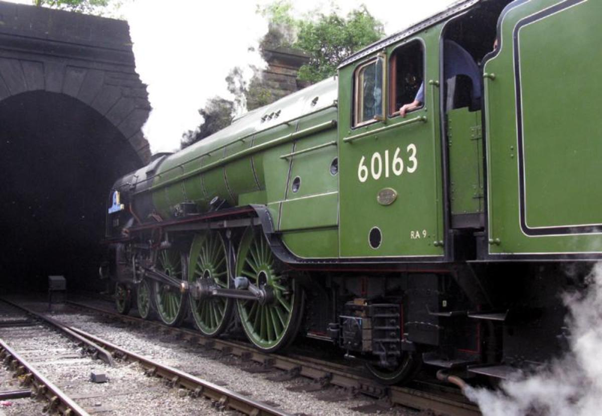 Motive power might be the new-ish A1 60163 'Tornado, seen here' entering Grosmont tunnel on her southward run to Pickering - or Deviation Shed for water and coal replenishment