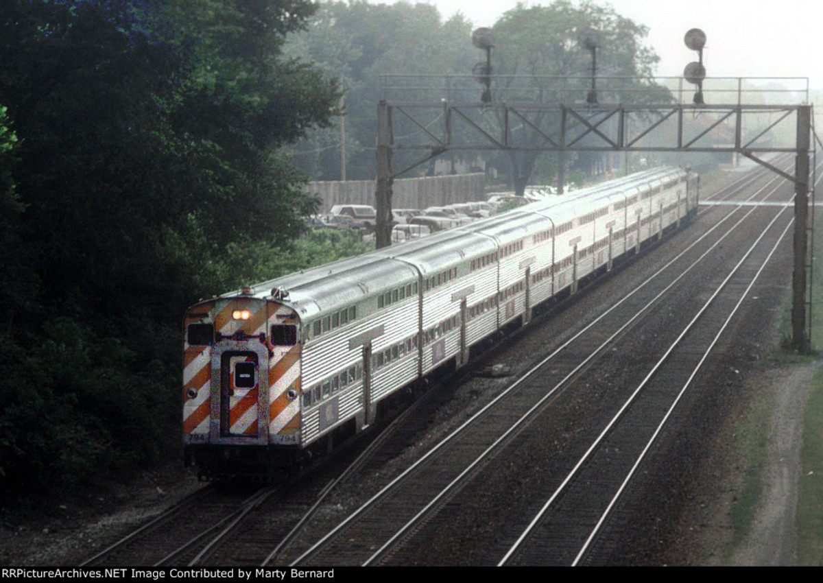 Cab car 794 Leads a morning inbound commuter train through Naperville. Photographer: Marty Bernard