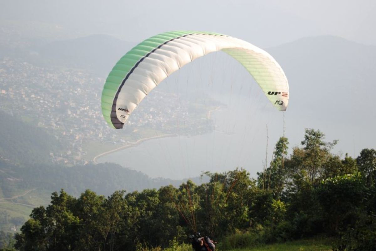 Paragliding in Pokhara valley. Pokhara is a lake city. Many popular trekking routes begins from Pokhara including the most challenging expedition of Mount Annapurna (8091 meters).