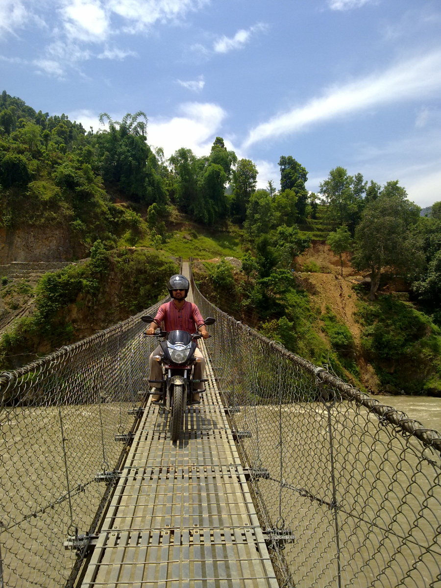 It is exciting to ride a motorbike on a suspension bridge.