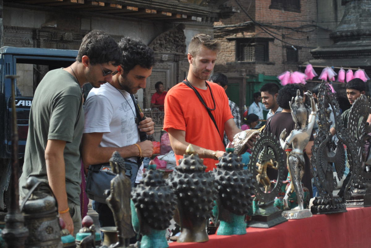 Tourists in Kathmandu making a bargain.