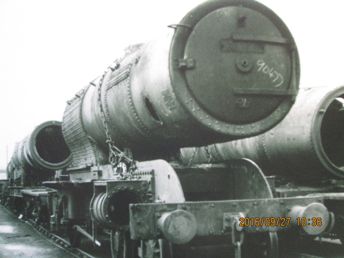 A completed boiler rests on a redundant NER Atlantic (4-4-2) locomotive frame, its cylinder housings and buffers still attached, screw coupling replaced by 3-link