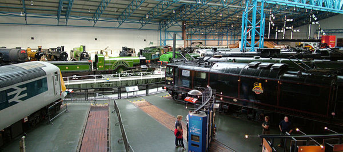 The NRM's Great Hall with locomotives of different vintage ranged around the 70' turntable (enlarged to accommodate York's fleet of Pacifics (4-6-2 Express Passenger locomotives, 11 in 1950, 7 in 1965)