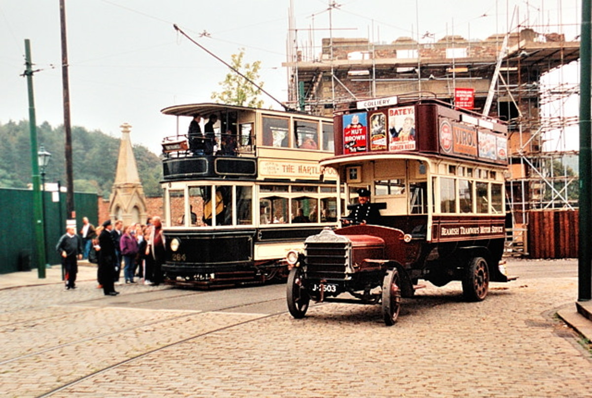 Beamish street scene with early double-decker 'knife-board' bus passing a double-decker tram. Double-decker trams were still fairly common on Britain's city and town streets until the 1950s