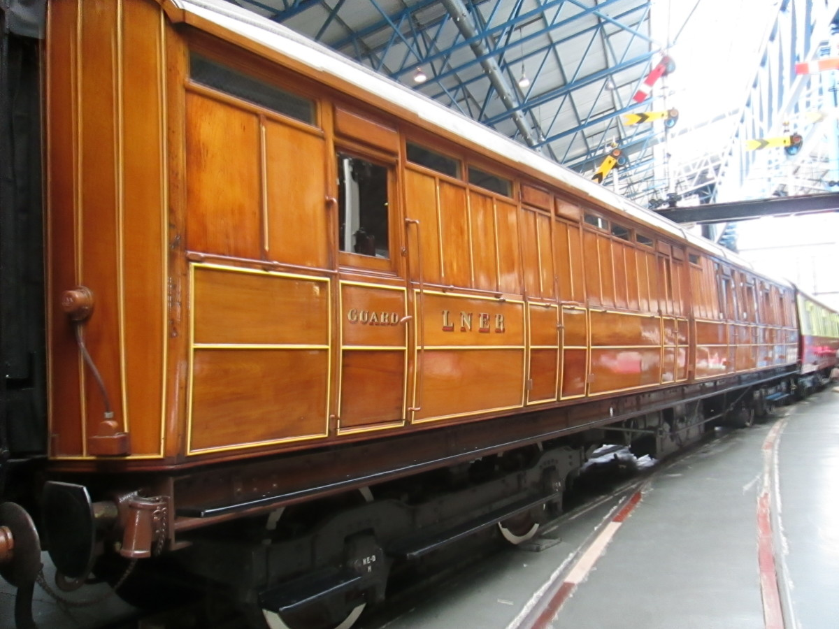 Next to the ECJS carriage above, a brake 3rd Class highly varnished teak bodied Gresley LNER carriage - note the handsome white-wall wheels,  finishing as standard in the 20s