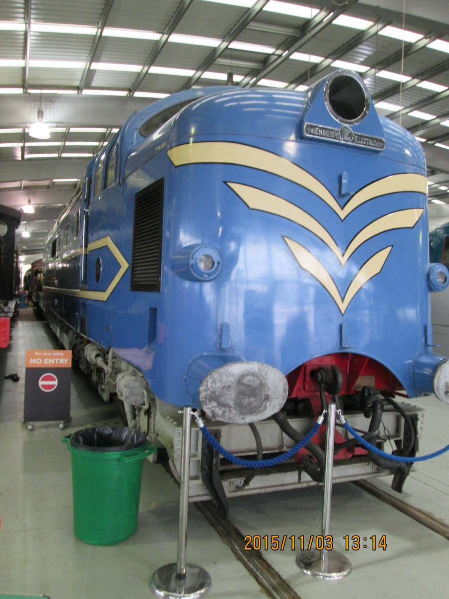 Prototype blue 'Deltic' diesel, 'Alycidon' with speed whiskers poses on the floor of the museum adjacent to 'Green Arrow'