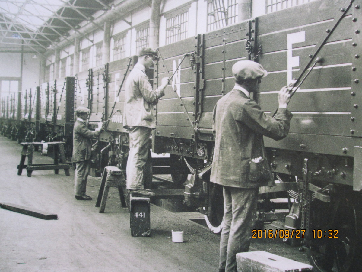 Wagons completed and painted, the time came for lettering & numbering. One man paints the 'N' in the left panel, his workmate adds the 'E'. 'NE' was the cypher for North Eastern and London & North Eastern Railway revenue earning wagons and vans