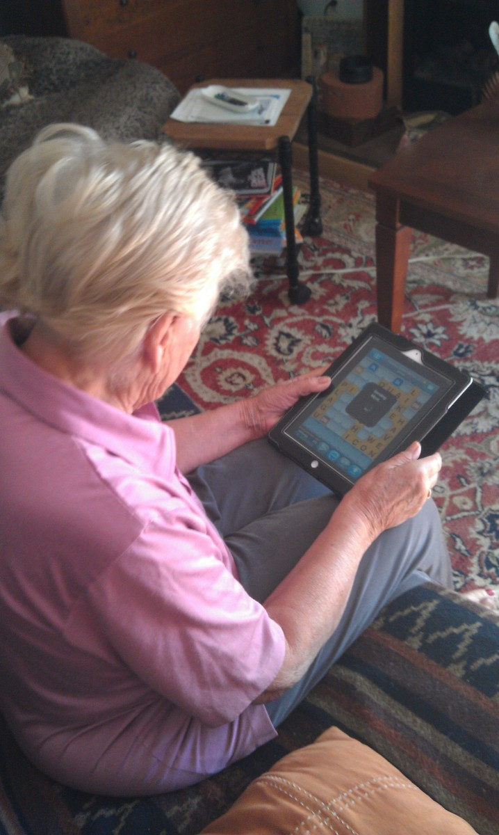 My mother playing 'Words with Friends' on her i Pad
