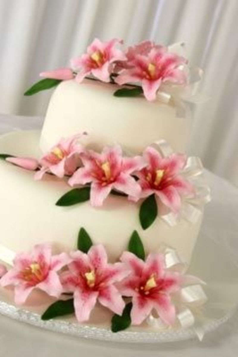 pink and white lily wedding cake