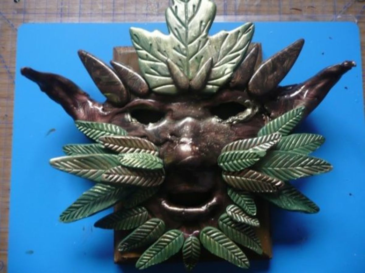 I created polymer clay leaves, which I painted and added to the mask