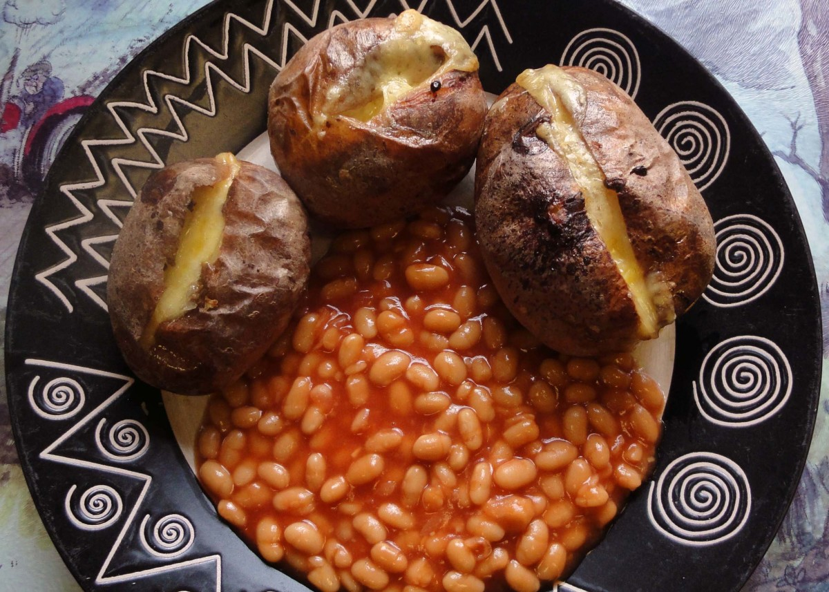 Jacket Potatoes stuffed with a slice of Cheddar Cheese and served with baked beans.