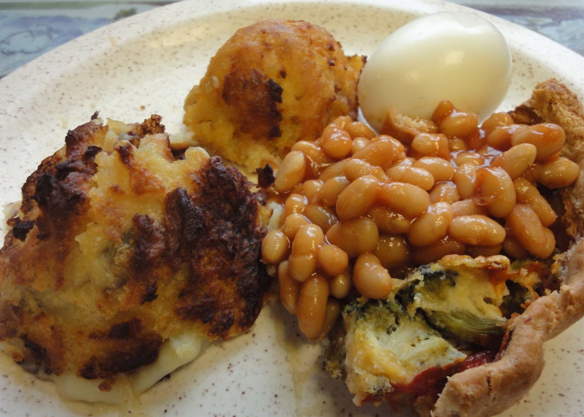 Quick Duchess Potatoes shaped with a potato scoop and served with vegetarian quiche topped with baked beans.