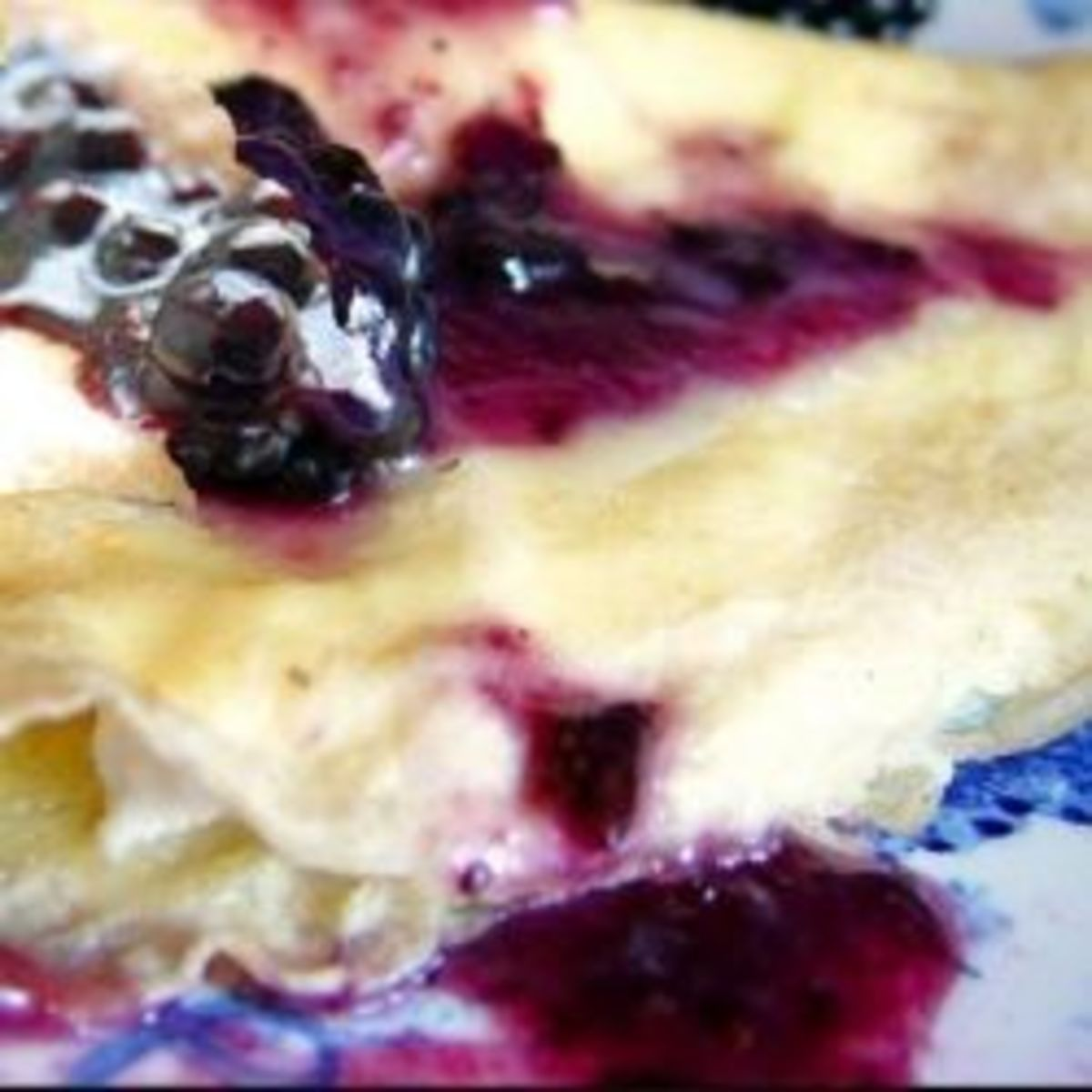 Delicious Blueberry blintzes made with paper thin crepes and a dollop of cream.