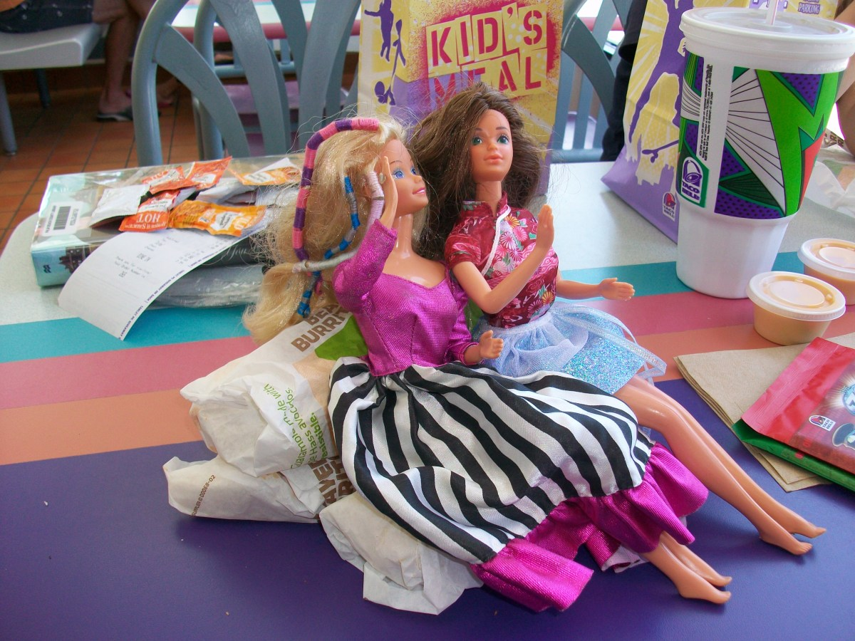Three bean burritos make a nice sofa for Barbie and her friend.