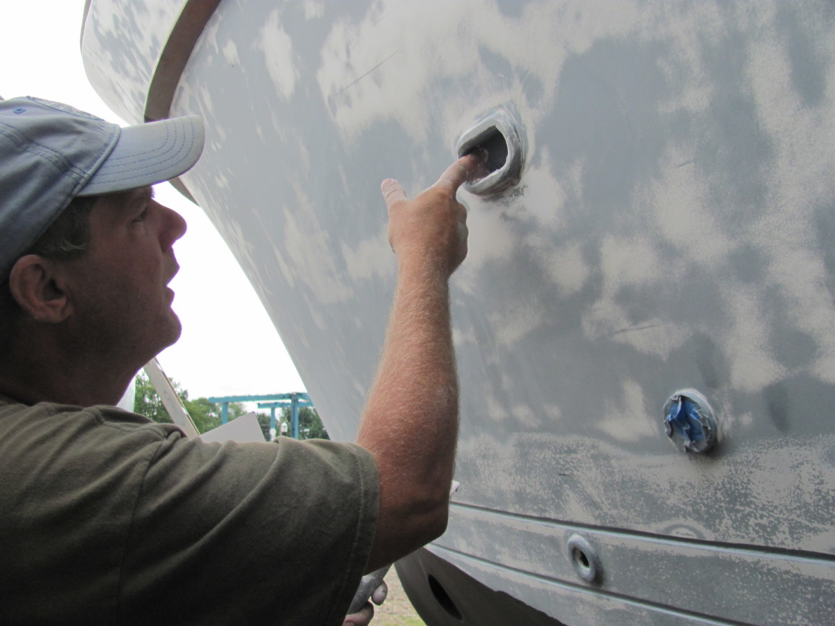 Luke applies some putty to fill in holes in the drain holes.