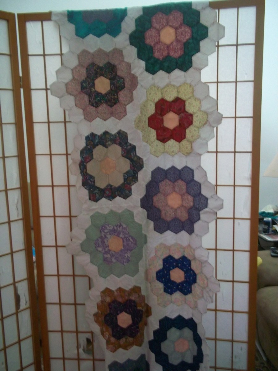 This is a partial quilt top made from double flowers - it is a WIP.
