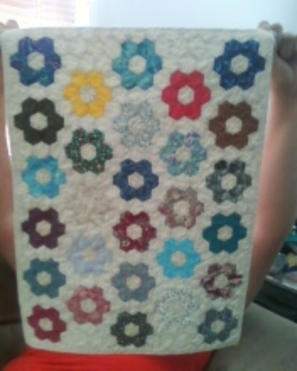 This particular miniature quilt took over 100 hours to hand piece; the hexagons are one inch wide.