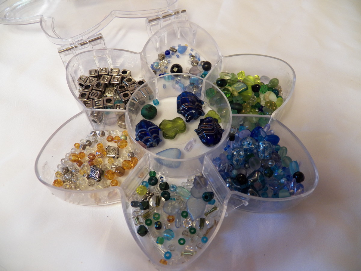 Beads organized by color and size.