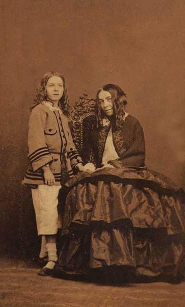 """Elizabeth Barret Browning and her son, """"Pen."""""""