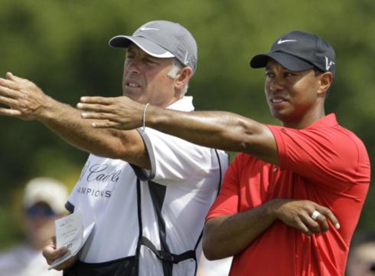 Steve Williams first day on the job with his young new boss. Good 'ol Stevie has a few things to show this skinny Eldrick Tiger Woods