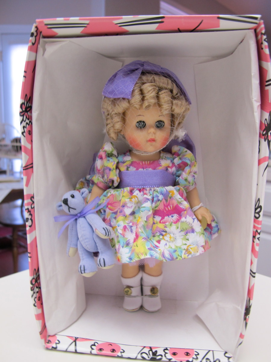 "This version of the Ginny Doll, complete with a matching teddy bear, is called ""Flower Time."""