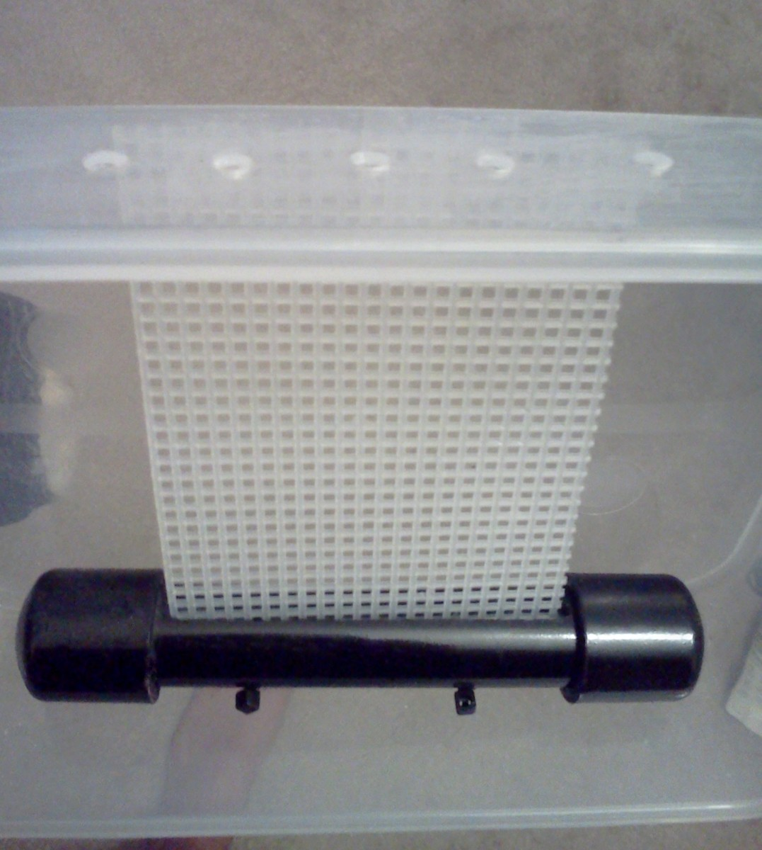 I drilled air holes in the top of scrubber (I also drilled 2 holes in the bottom so the 2 plastic tubes on the bottom of the PVC screen holder could fit snug)