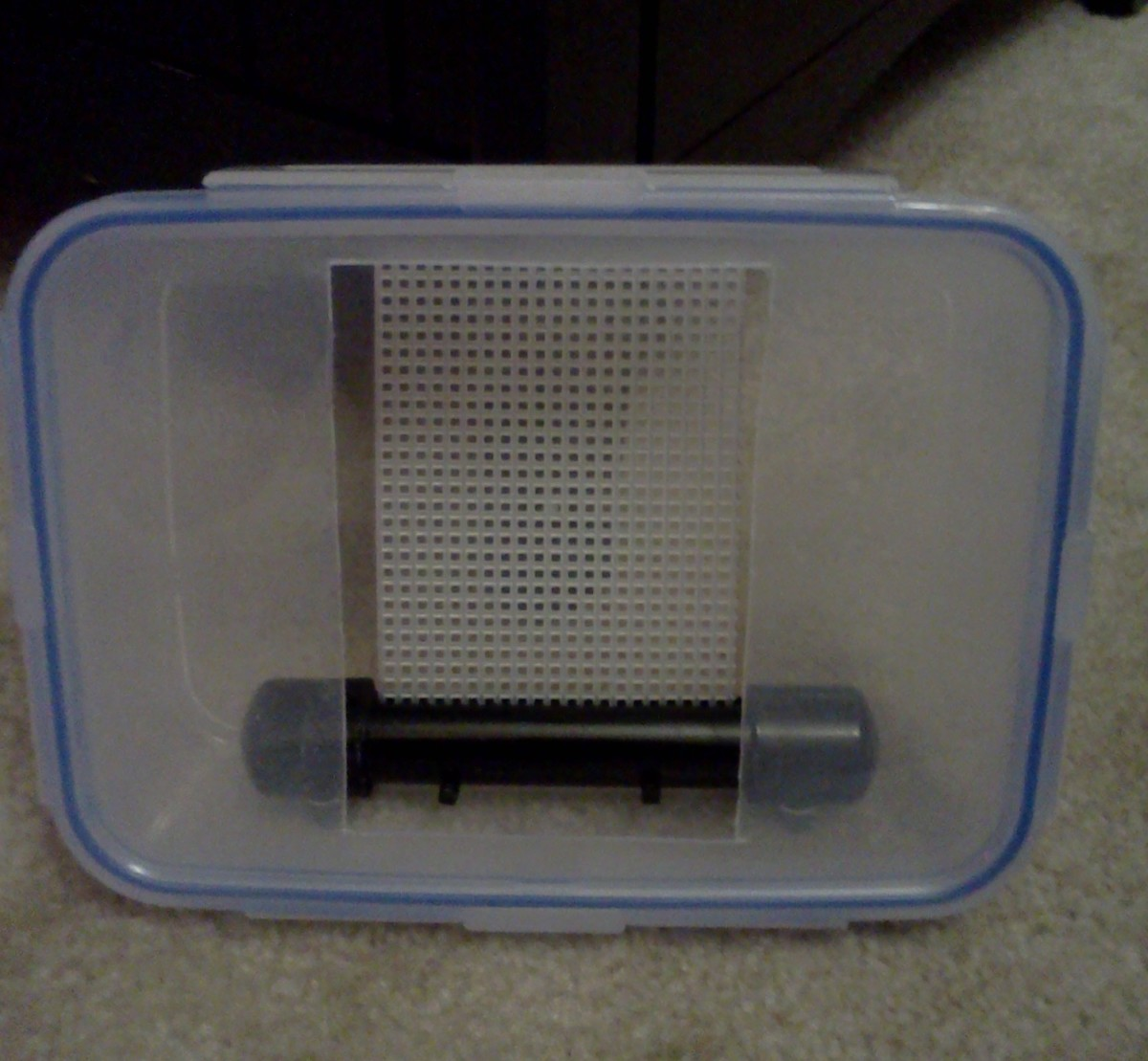 Face plate (lid) attached to scrubber with scrubber screen mounted inside
