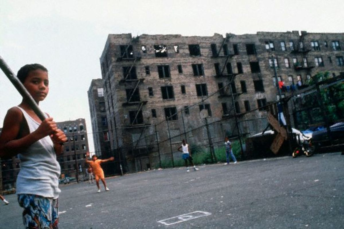 Kids play ball near their homes in the Bronx, New York City.