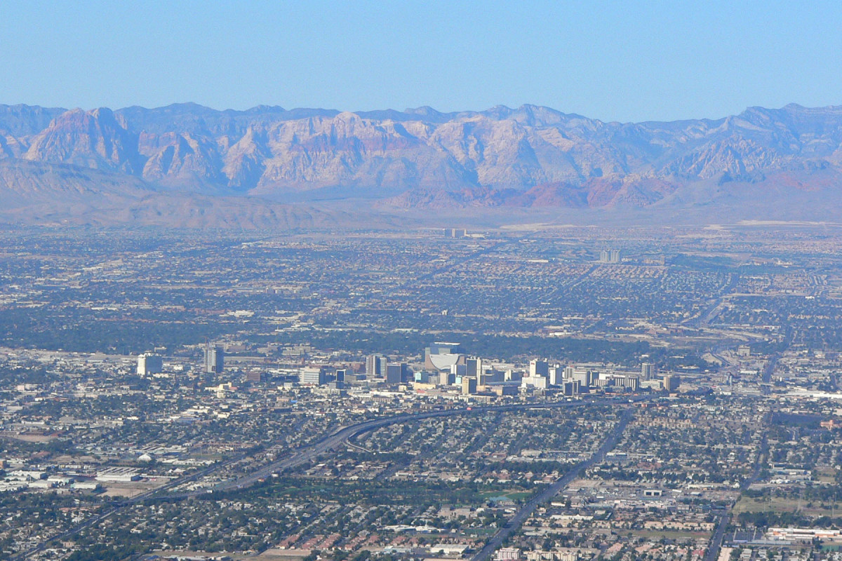 Looking west from Frenchman Mountain across Las Vegas.  Las Vegas Strip (center).  Red Rock Casino and beautiful Red Rock Canyon are in the distance.