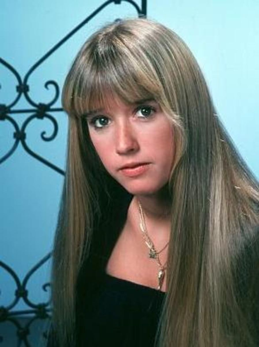 A young Kim Richards with ashy blonde hair