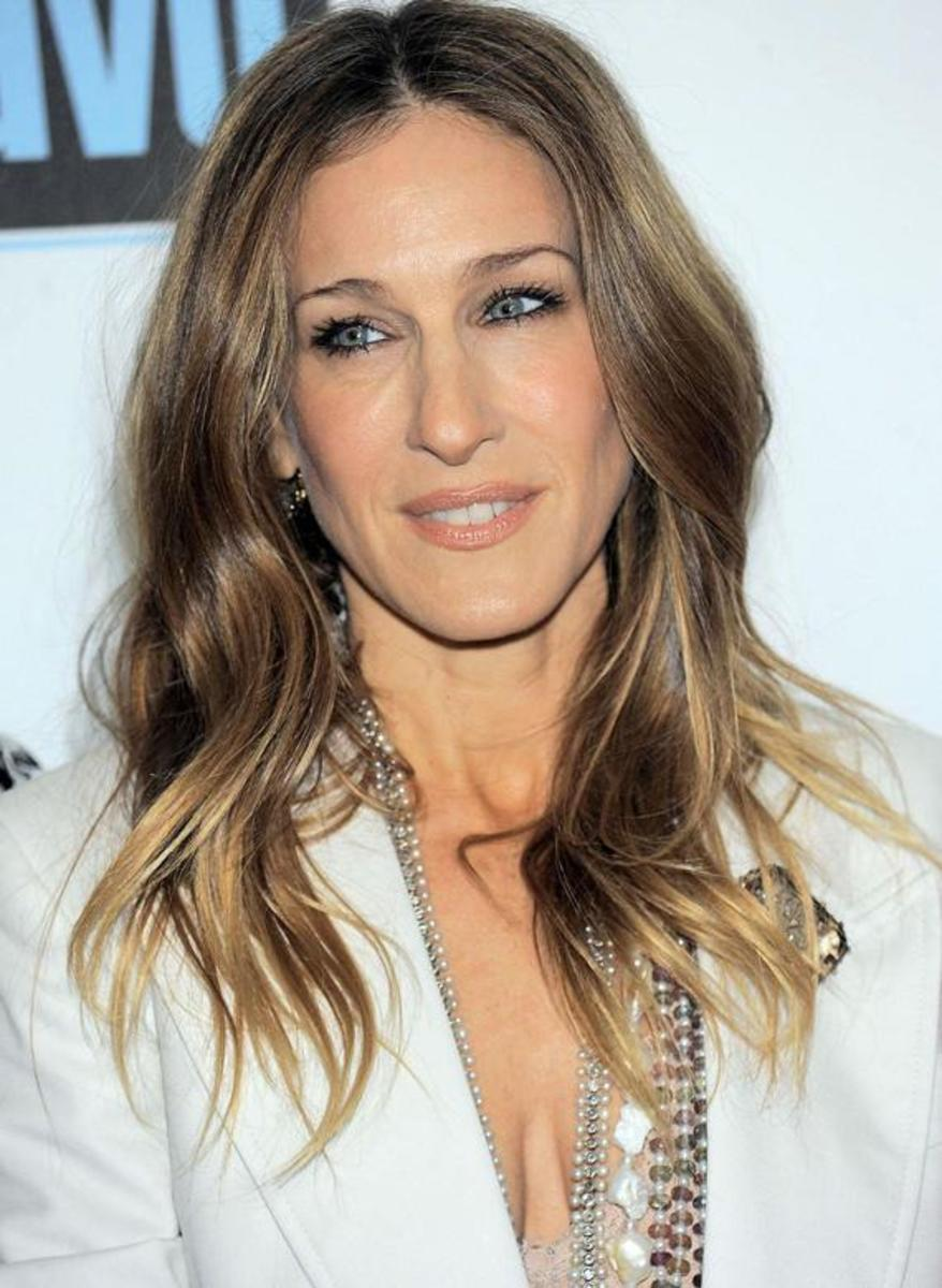 Sarah Jessica Parker with dark ash blonde hair color, slightly wavy and center-parted. Celebrities with dark ash blonde hair color.