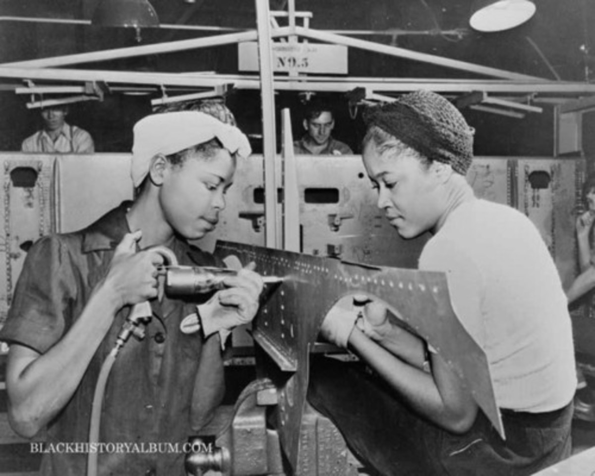 Riveters working on ship parts