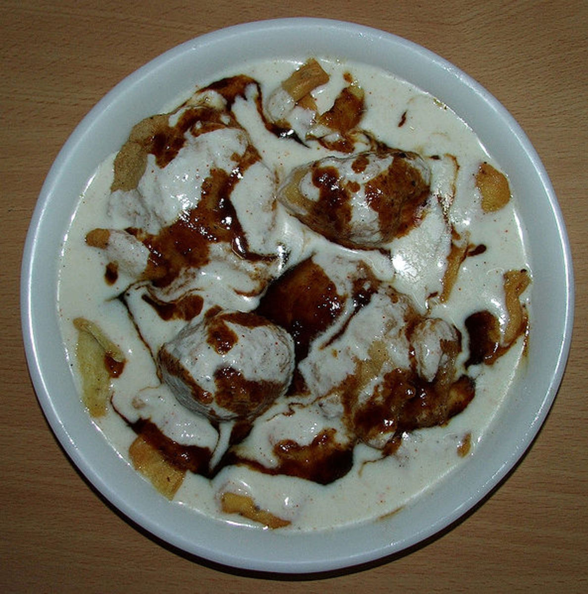 This salad contained crisp lenthil crackers soaked in curd or yogurt swirled with tamarind chutney and boiled potatoes