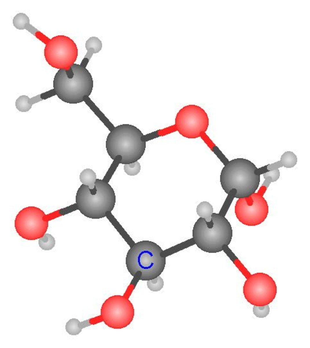 Ball and stick model of a glucose molecule. Dark gray balls are carbon atoms, red balls are oxygen atoms and small light gray balls are hydrogen atoms