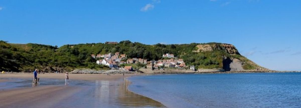 Runswick Bay foreshore at low tide on a sunny summer's afternoon is a welcome sight for paddlers and swimmers - although keep an eye on the flagpost - red flyer means danger for the adventurous, keep to the shallows (Rip tides are fast here)!