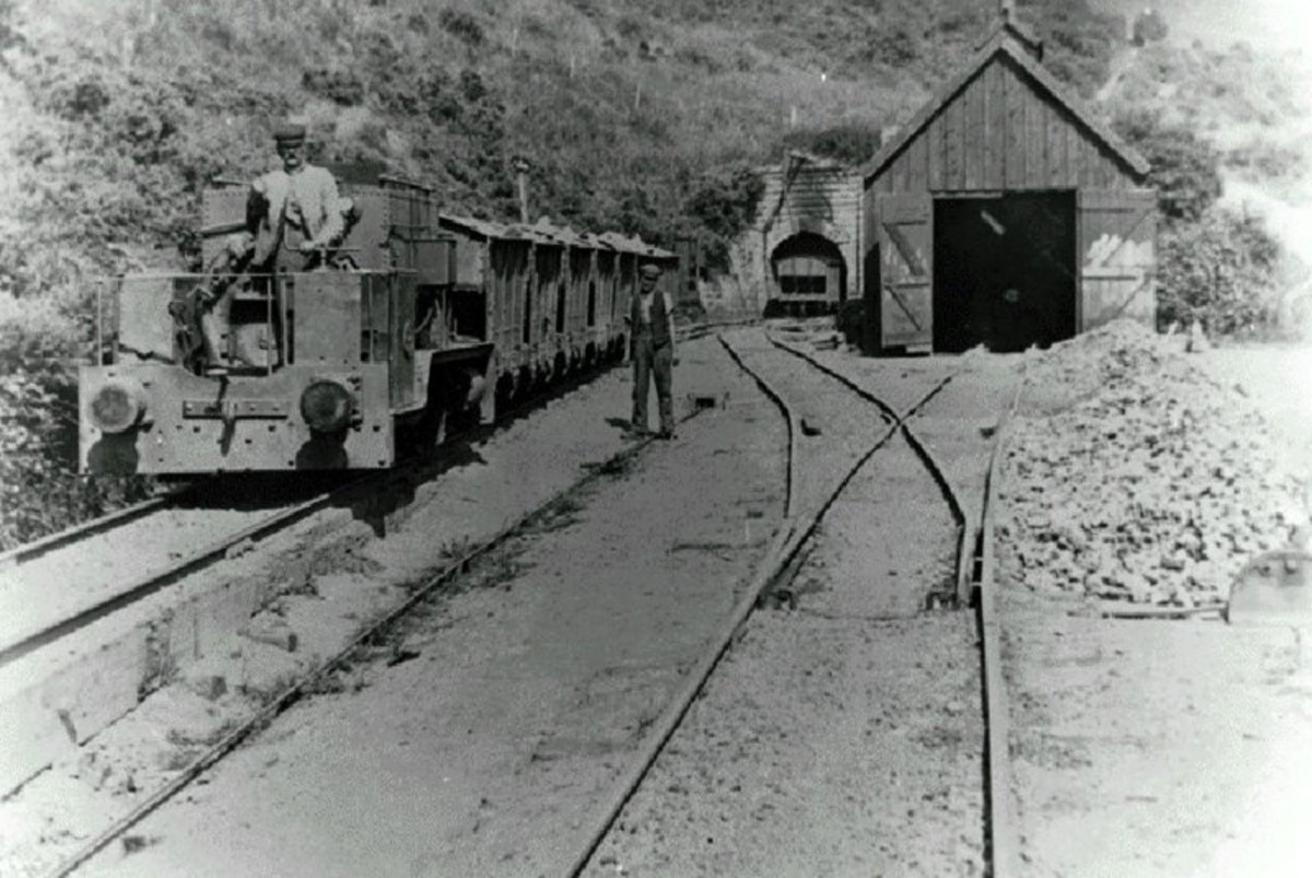 An electric locomotive draws wagons from the Grinkle Mine (ironstone) at Dale Head towards the loading derrick at Port Mulgrave